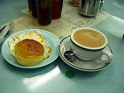 Milk tea, a bun and eggs for breakfast in a chachaanteng restaurant.